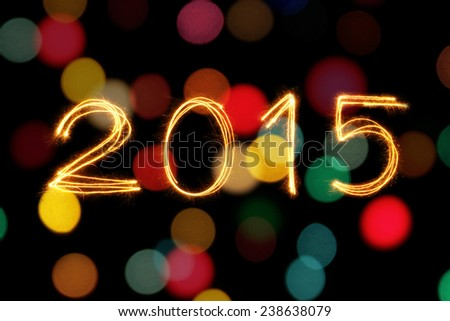 New Year 2015 sparkle firework with defocused dirty circle light blur bokeh background - stock photo