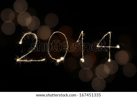 New year 2014 sparklers firework with bokeh - stock photo