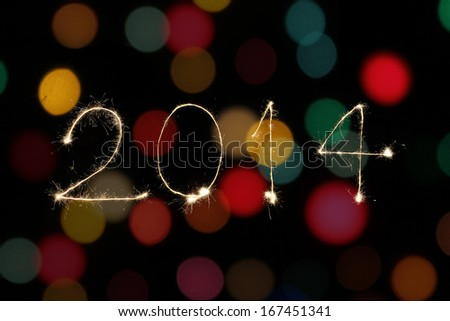 New year 2014 sparklers firework with coloful bokeh - stock photo