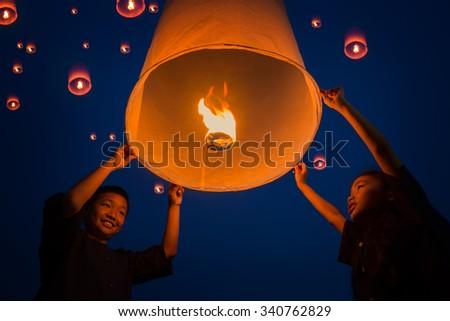 New year, Thai people floating lamp in Tudongkasatarn, Chiangmai, Thailand. Tudongkasatarn is where floating lamp ceremony takes place every year. - stock photo