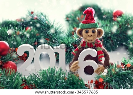 New Year 2016 the year of the monkey . Homemade toy monkey with a Christmas decorations .Symbol of 2016 New Year . - stock photo
