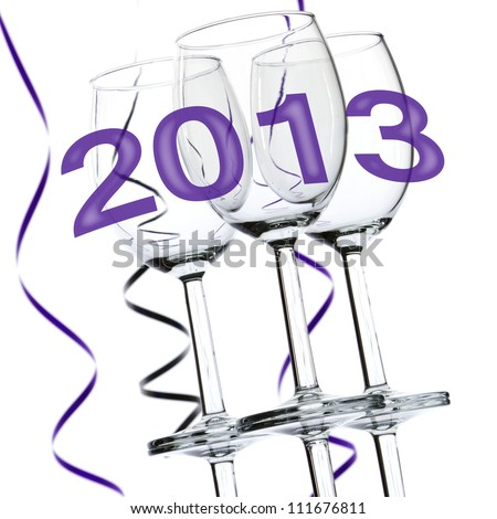 New Year 2013 theme with three wine glasses and party streamers isolated on white background. - stock photo