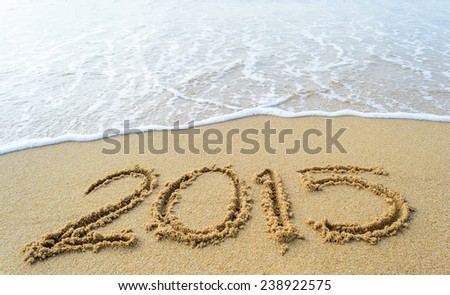 New year,2015 write on sand beach and ocean view.  - stock photo
