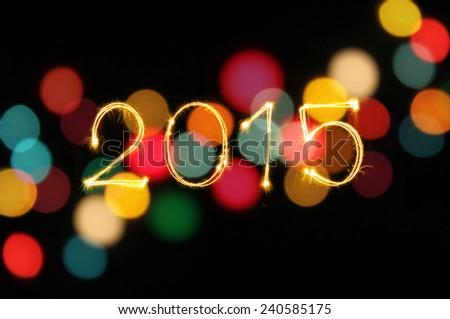 New Year 2015 writing sparkle firework figures - stock photo