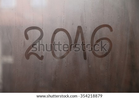 New Year 2016 written on the glass