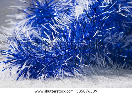 New years blue and white tinsel. Background Christmas theme - stock photo