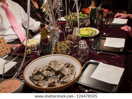 New years dinner party with oysters and champagne - stock photo