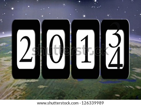 new years'e eve odometer on outer space background - stock photo