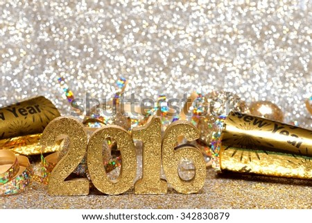 New Years Eve 2016 golden numbers and decorations with twinkling light background - stock photo