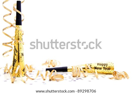 New Years Eve party noisemaker border with confetti and streamers over a white background - stock photo