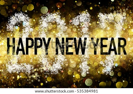 New years greeting for year 2017 on a golden bokeh style background.
