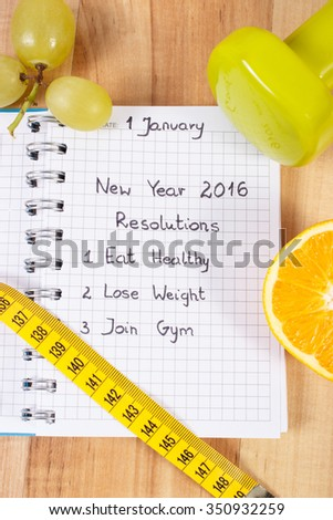 New years resolutions eat healthy, lose weight and join gym written in notebook, dumbbells for fitness with tape measure, concept of healthy lifestyle - stock photo