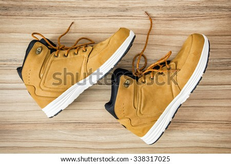 New yellow teenage textile shoes. Beauty and fashion. - stock photo