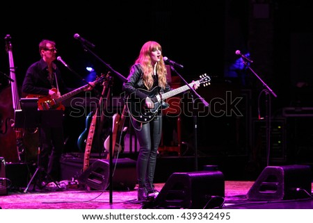 NEW YORK-APR 30: Aubrey Peeples performs onstage during the 'Nashville' Tour at The Beacon Theatre on April 30, 2015 in New York City.