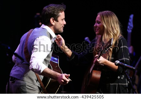 NEW YORK-APR 30: Charles Esten (L) greets Lennon Stella onstage during the 'Nashville' Tour at The Beacon Theater on April 30, 2015 in New York City. - stock photo