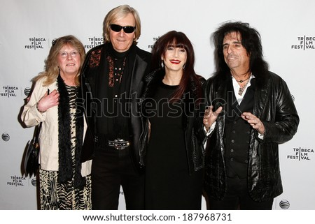 NEW YORK-APR 17: (L-R) Rose Smith, Neal Smith, Sheryl Goddard and Alice Cooper attend the 'Super Duper Alice Cooper' premiere at Chelsea Bow Tie Cinemas on April 17, 2014 in New York City. - stock photo
