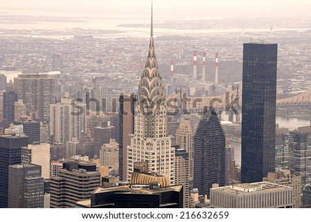 NEW YORK - APRIL 10: A captivating aerial view of the Chrysler Building, Manhattan skyscrapers and buildings from the top of the Empire State Building on April 10, 2011. - stock photo