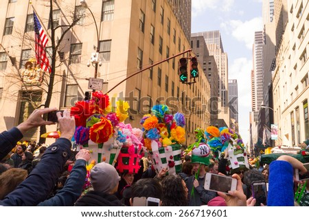 NEW YORK - APRIL 5:  A group of people with very large and creative easter bonnets pose for pictures during The 2015 Easter Parade - stock photo