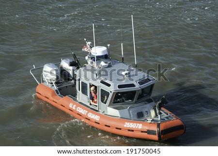 NEW YORK - APRIL 19: A United States Coast Guard boat patrols the Hudson River.  Photograph taken April 19, 2008. - stock photo