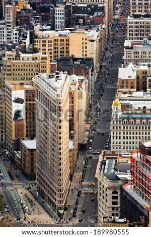 NEW YORK - APRIL 27, 2014: Aerial view of the 5th avenue and the Flat Iron building, one of the world's most iconic skyscrapers. The buildings glow under the sunset light.