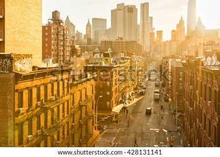 NEW YORK - APRIL 18, 2015: Madison Street in Manhattan's Chinatown on a sunny afternoon. Chinatown is home to the largest enclave of Chinese people in the Western Hemisphere