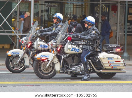 NEW YORK - APRIL 1: NYPD officers on motorcycles providing security in Manhattan on April 1, 2014. New York Police Department, established in 1845, is the largest police force in USA  - stock photo
