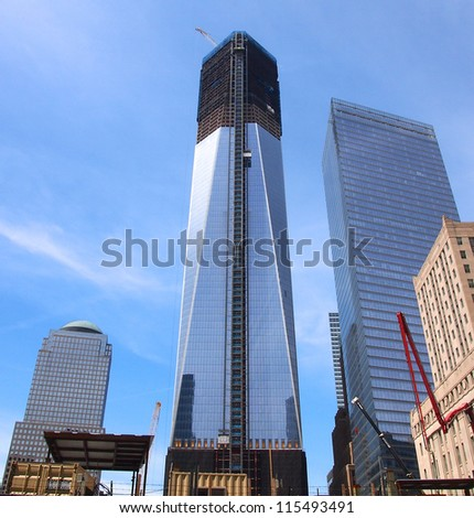 NEW YORK - APRIL 30: One World Trade Center seen under construction April 30, 2012 in New York City. Nicknamed the Freedom Tower, the skyscraper became the tallest building in New York April 30. - stock photo