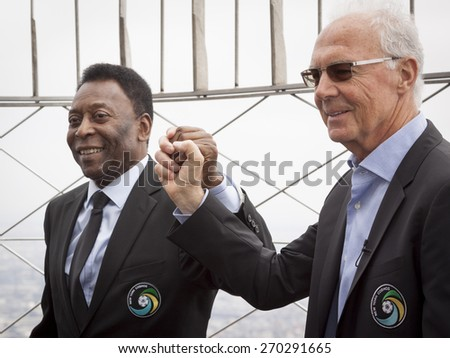 NEW YORK - APRIL 17, 2015: Soccer legends Pele and Franz Beckenbauer from the New York Cosmos on the observation deck of the Empire State Building to launch and celebrate the start of the 2015 season. - stock photo