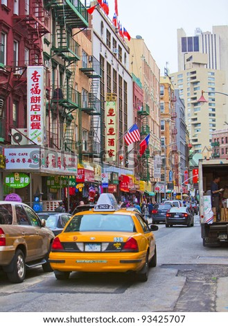 NEW YORK - APRIL 18: Street in New York's famous Chinatown along East Broadway on April 18th, 2011 in New York, NY, USA. - stock photo