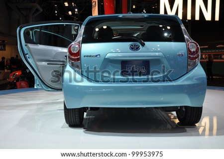 NEW YORK - APRIL 11: The Toyota Prius C at the 2012 New York International Auto Show running from April 6-15, 2012 in New York, NY. - stock photo