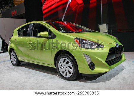 NEW YORK - APRIL 1: Toyota exhibit Prius c  at the 2015 New York International Auto Show during Press day,  public show is running from April 3-12, 2015 in New York, NY. - stock photo