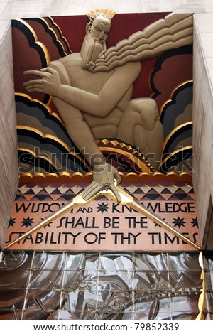 NEW YORK - APRIL 7: Wisdom, an art deco piece by Lee Lawrie, shown here April 7, 2011, is located at the entrance of 30 Rockefeller Plaza in New York, NY. It was featured on a US postal stamp in 2003. - stock photo