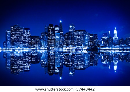 New York at night with reflection in water with blue hue - stock photo