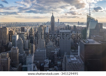 New York attractions and sightseeing: City view with skyscrapers during sunset, seen from the Rock observation center.New York has architecturally significant buildings in a wide range of styles