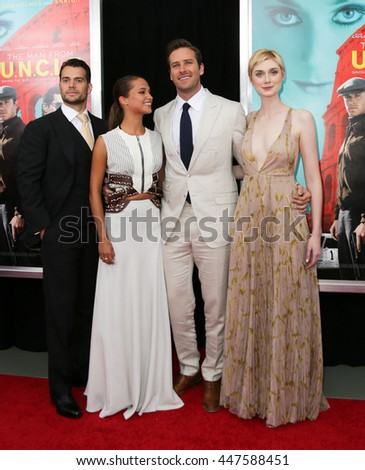 "NEW YORK-AUG 10: (L-R) Actors Henry Cavill, Alicia Vikander, Armie Hammer and Elizabeth Debicki attend ""The Man From U.N.C.L.E."" premiere at the Ziegfeld Theatre on August 10, 2015 in New York City. - stock photo"