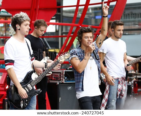 NEW YORK-AUG 26: (L-R) Niall Horan, Liam Payne & Harry Styles of One Direction perform on NBC's 'Today Show' at Rockefeller Plaza on August 23, 2013 in New York City. - stock photo