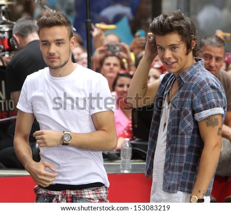 NEW YORK - AUG 23: Liam Payne and Harry Styles of One Direction performs on NBC's Today Show at Rockefeller Plaza on August 23, 2013 in New York City. - stock photo