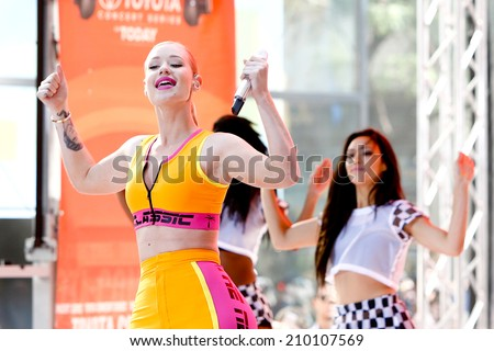 "NEW YORK-AUG 8: Recording artist Iggy Azalea performs in concert at NBC's ""Today Show"" at Rockefeller Plaza on August 8, 2014 in New York City. - stock photo"