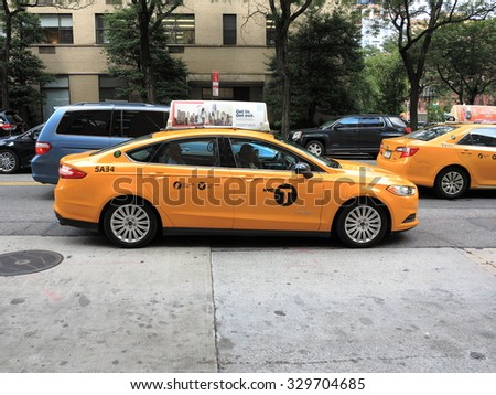 NEW YORK - AUGUST 11: A NYC taxi at a crosswalk on August 11, 2015 in New York. Yellow medallion taxis are able to pick up passengers anywhere in the five boroughs of the city.  - stock photo