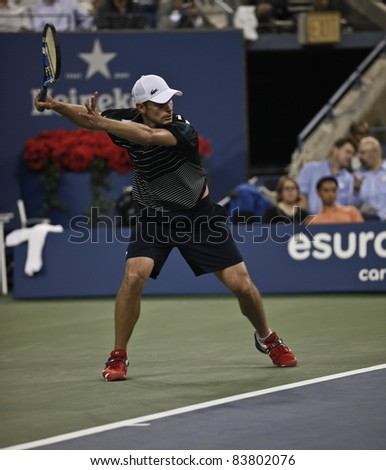 NEW YORK - AUGUST 31: Andy Roddick of USA returns ball during 1st round match against Michael Russell of USA at USTA Billie Jean King National Tennis Center on August 31, 2011 in New York City. - stock photo