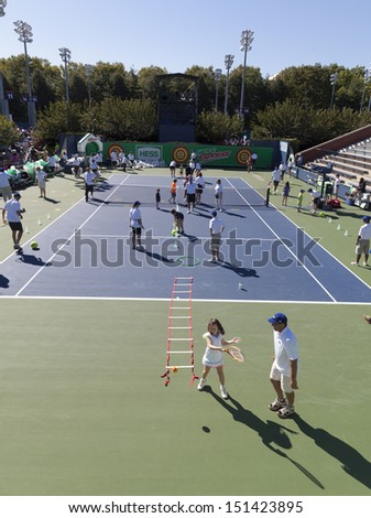 NEW YORK - AUGUST 24: Atmosphere during Arthur Ashe Kids Day presentation at USTA Billie Jean King National Tennis Center on August 24, 2013 in New York City - stock photo