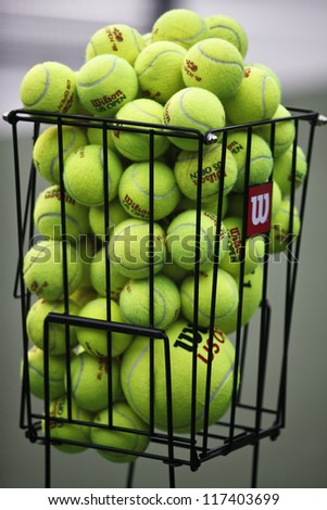 NEW YORK - AUGUST 27: Basket with official Wilson balls at the opening ceremony at US Open tennis tournament on August 27, 2012 in Flushing Meadows New York - stock photo