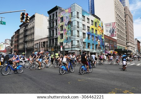 NEW YORK - AUGUST 8, 2015: Bicyclists at Lafayette Avenue during Summer Streets Saturday in New York. Summer Streets is an annual celebration of New York City's most valuable public space our streets - stock photo