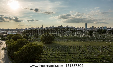 NEW YORK - AUGUST 21: Calvary Cemetery on August 21, 2013 in New York. Calvary Cemetery is a cemetery in Queens, containing more than 3 million burials. - stock photo
