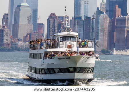 NEW YORK - AUGUST 2014: Cruise yacht with Manhattan skyline in the background on August 11, 2014. Manhattan is the central part of NYC. It is one of the worlds leading cultural and economic centers. - stock photo