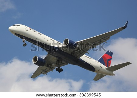 NEW YORK - AUGUST 13, 2015: Delta Airlines Boeing 757 descending for landing at JFK International Airport in New York - stock photo