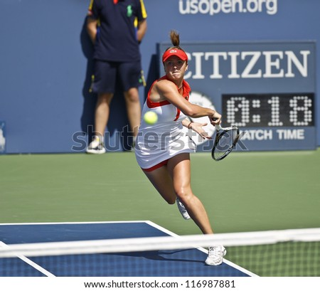 NEW YORK - AUGUST 28: Elina Svitolina of Ukraine returns ball during 1st round match against Ana Ivanovic of Serbia at US Open tennis tournament on August 28, 2012 in Flushing Meadows New York - stock photo