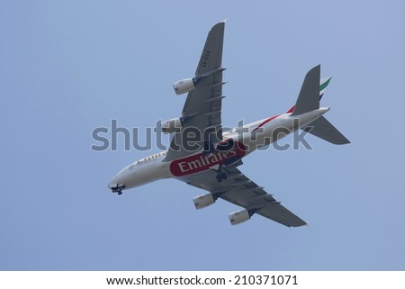 NEW YORK - AUGUST 10: Emirates Airline Airbus A380 in New York sky before landing at JFK Airport on August 10, 2014. The Airbus A380 is a double-deck, wide-body, world's largest passenger airliner  - stock photo