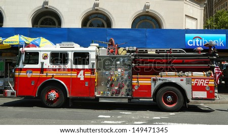 NEW YORK - AUGUST 6: FDNY Engine 4 in Lower Manhattan on August 6, 2013. FDNY is the largest combined Fire and EMS provider in the world  - stock photo