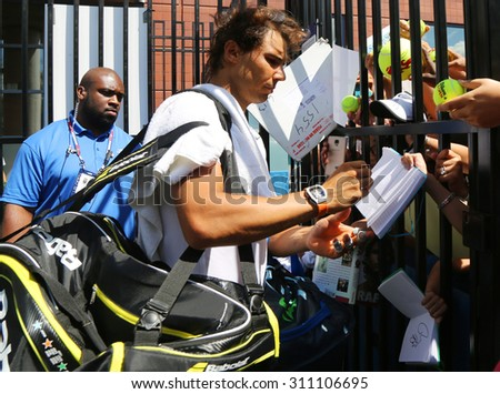 NEW YORK - AUGUST 27, 2015: Fourteen times Grand Slam champion Rafael Nadal of Spain signing autographs after practice for US Open 2015 at Billie Jean King National Tennis Center in New York - stock photo
